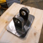 Lifting bracket and absorber set